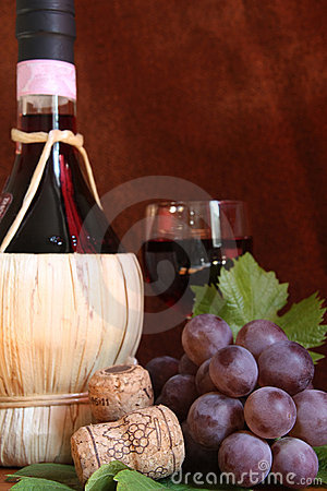 Chianti wine bottle with grape and corks