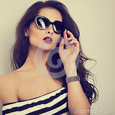 Free Chic Female Model With Long Hair Posing In Fashion Sunglasses In Stock Image - 87883461