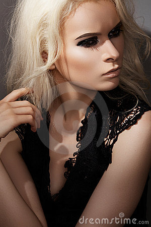 Chic rock style. Fashion blond model with make-up