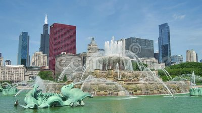 Chicago Downtown Skyline from the Buckingham Fountain View. Chicago downtown skyscrapers behind the Buckingham Fountain waters. The Willis Tower, the CNA Center stock footage