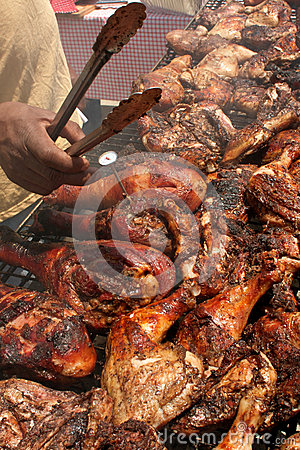 Chicken Barbequeing On Grill At Outdoor Festival
