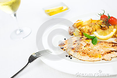 Chicken breast grilled with vegetables and spice