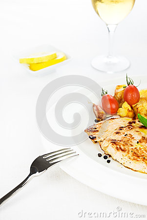 Chicken breast grilled with vegetables and spices