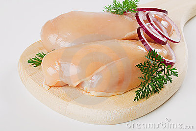 Chicken breast meat on wooden board