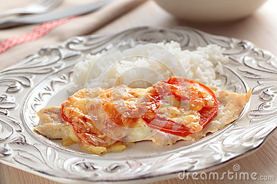Chicken breasts with tomato and rice