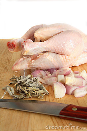 Chicken on chopping board