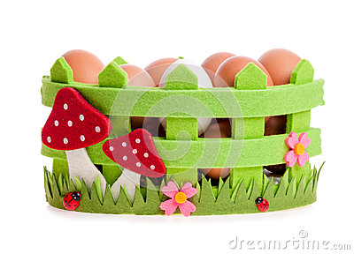 Chicken eggs in the green decorative basket
