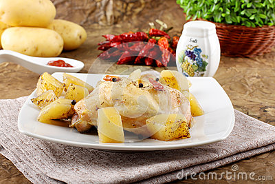 Chicken leg baked with potatoes