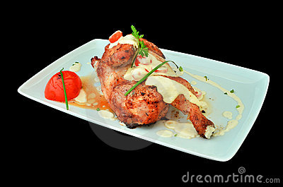Chicken leg cooked in oven with white sauce