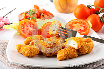 Chicken nuggets on dish