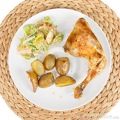 Chicken with potato wedges and salad