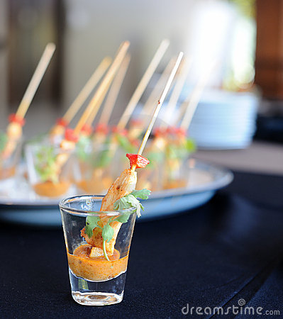 Chicken satay skewers served in a glass