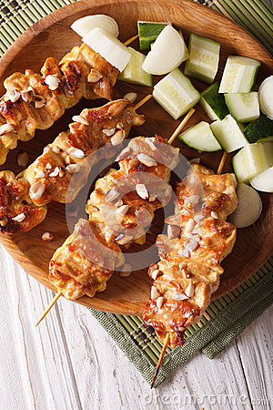 Free Chicken Satay Sprinkled With Peanuts Close-up. Vertical Top View Stock Images - 58388594