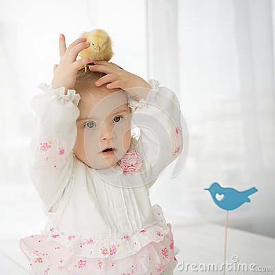 Free Chicken Sitting On The Head Of A Little Baby Girl With Down Syndrome Stock Photos - 39690093