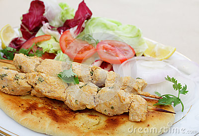 Chicken tikka kebab meal side view