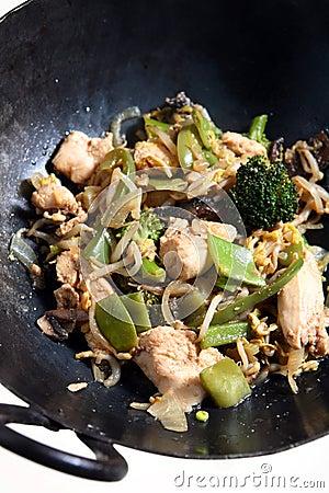 Chicken vegetable stir-fry in a wok