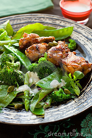 Chicken wings and vegetable salad