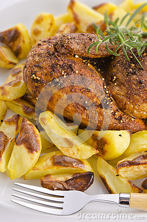 Chickens roast with baking potatoes