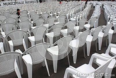 Child playing among empty seats
