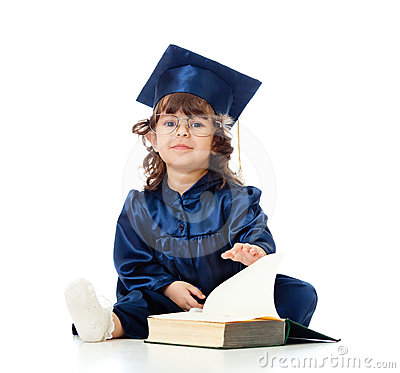 Child in academician clothes with book