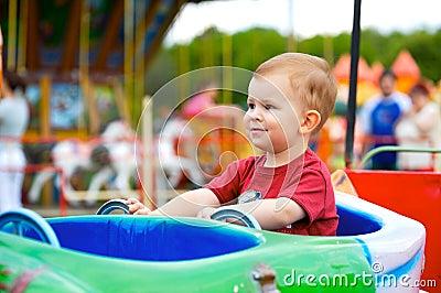 Child in amusement park