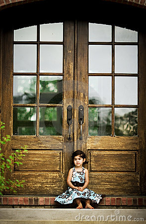 Child and antique door