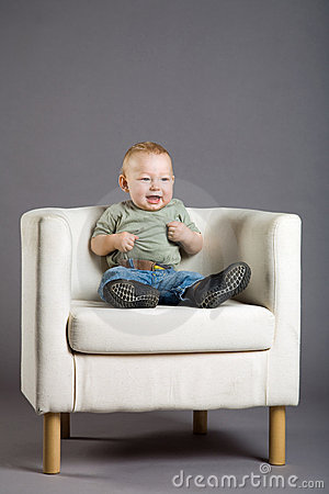 Child in armchair