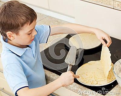 Child bakes pancakes