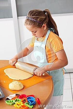 Child baking cookies