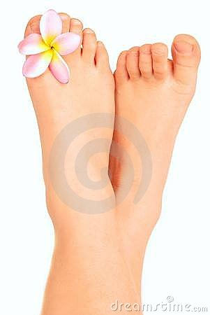Child bare little feet with flower