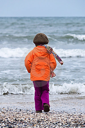 Child on beach back view autumn
