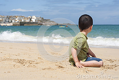 Child on beach in Cornwall