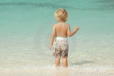 Child at the beach on a summer day
