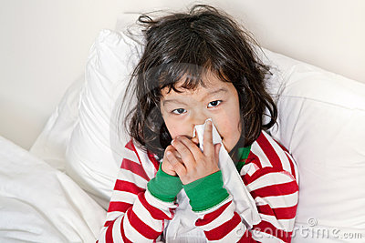 Child in Bed with Cold and Sniffles