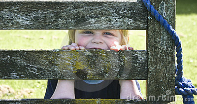 Child behind a bench