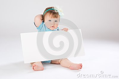 Child behind empty board