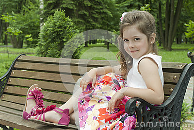 Child on a bench in park