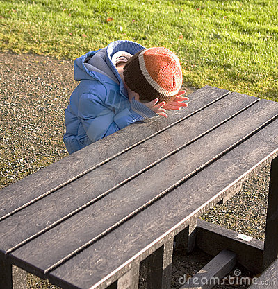 Child on bench in park