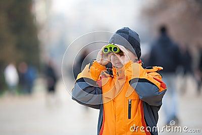 Child with binoculars outdoor