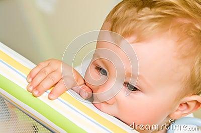 Child biting playpen rail