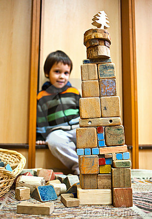 Child with blocks construction