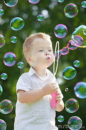 Child blow bubbles