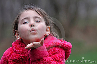 Child blowing kiss