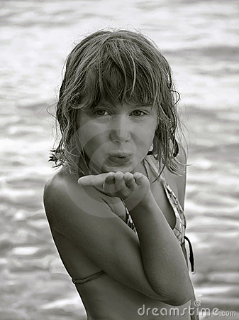 Child blowing you a kiss
