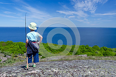 Child boy plans fishing