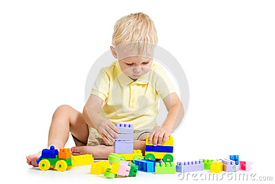 Child boy playing with construction set