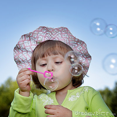 Child and bubble outdoors
