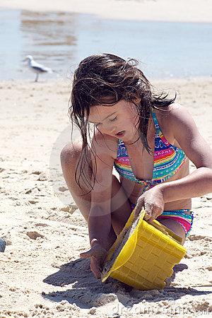 Child building a sand castle