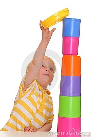 Child builds stacking tower
