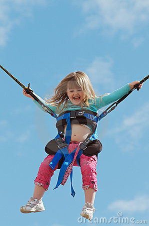 Child on bungee trampoline